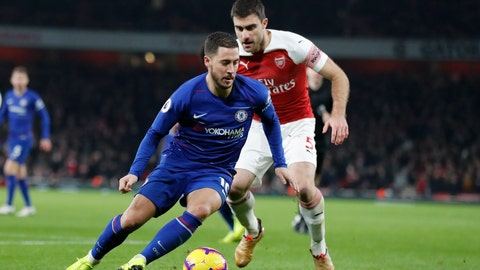 <p>               Chelsea's Eden Hazard, left vies for the ball with Arsenal's Sokratis Papastathopoulos during the English Premier League soccer match between Arsenal and Chelsea at the Emirates stadium in London, Saturday, Jan. 19, 2019. (AP Photo/Frank Augstein)             </p>