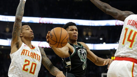 <p>               Milwaukee Bucks' Giannis Antetokounmpo, center, passes between Atlanta Hawks' John Collins (20) and Dewayne Dedmon (14) during the second half of an NBA basketball game Friday, Jan. 4, 2019, in Milwaukee. (AP Photo/Aaron Gash)             </p>