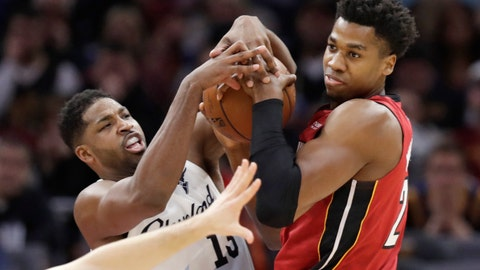 <p>               Cleveland Cavaliers' Tristan Thompson, left, and Miami Heat's Hassan Whiteside battle for the ball in the first half of an NBA basketball game, Wednesday, Jan. 2, 2019, in Cleveland. (AP Photo/Tony Dejak)             </p>