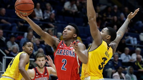 <p>               Arizona's Brandon Williams (2) lays up a shot past California's Paris Austin, right, during the second half of an NCAA college basketball game Saturday, Jan. 12, 2019, in Berkeley, Calif. (AP Photo/Ben Margot)             </p>