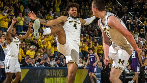 <p>               Michigan guard Zavier Simpson (3) and forward Isaiah Livers (4) celebrate with center Jon Teske, right, after Teske made consecutive three-point baskets in the first half of an NCAA college basketball game against Northwestern at Crisler Center in Ann Arbor, Mich., Sunday, Jan. 13, 2019. (AP Photo/Tony Ding)             </p>