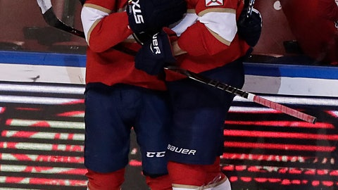 <p>               Florida Panthers center Vincent Trocheck, left, Florida Panthers defenseman Aaron Ekblad celebrate a Trocheck scoring a point during the third period of an NHL hockey game against the San Jose Sharks, Monday, Jan. 21, 2019, in Sunrise, Fla. (AP Photo/Brynn Anderson)             </p>