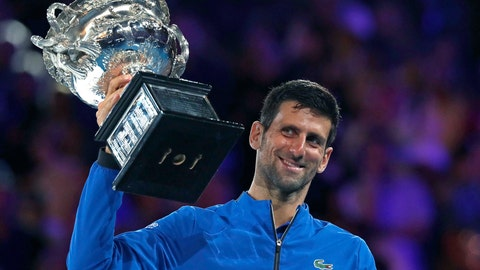 <p>               Serbia's Novak Djokovic holds his trophy aloft after defeating Spain's Rafael Nadal in the men's singles final at the Australian Open tennis championships in Melbourne, Australia, Sunday, Jan. 27, 2019. (AP Photo/Kin Cheung)             </p>