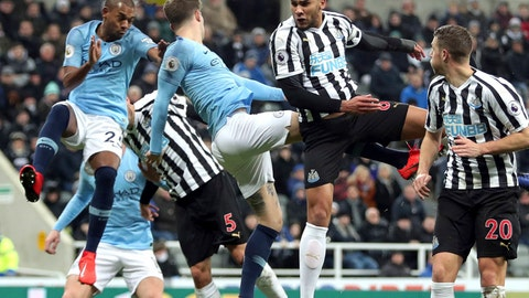 <p>               Newcastle United's Jamaal Lascelles, 2nd right, and Manchester City's John Stones, centre, in action for an aerial ball during their English Premier League soccer match at St James' Park in Newcastle, England, Tuesday Jan. 29, 2019. (Richard Sellers/PA via AP)             </p>