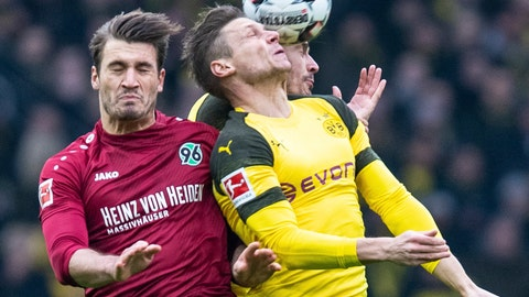 <p>               Hannover's Hendrik Weydandt, left, and Dortmund's Lukasz Piszczek fight for the ball during a Bundesliga soccer match between Hannover 96 and Borussia Dortmund in Hannover, Germany, Saturday, Jan. 26, 2019. (Guido Kirchner/dpa via AP)             </p>