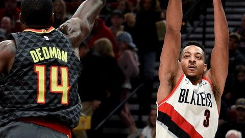 <p>               Portland Trail Blazers guard CJ McCollum, right, hits a shot over Atlanta Hawks center Dewayne Dedmon during the second half of an NBA basketball game in Portland, Ore., Saturday, Jan. 26, 2019. (AP Photo/Steve Dykes)             </p>