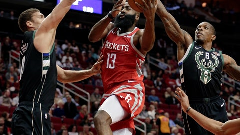 <p>               Houston Rockets guard James Harden (13) puts up a shot between Milwaukee Bucks center Brook Lopez (11) and guard Eric Bledsoe (6) during the first half of an NBA basketball game Wednesday, Jan. 9, 2019, in Houston. (AP Photo/Michael Wyke)             </p>