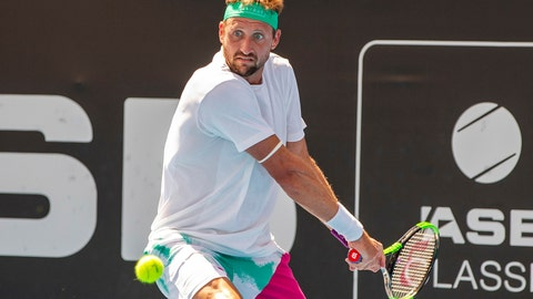 <p>               Tennys Sandgren of the U.S. plays a shot against Britain's Cameron Norrie during their singles final match in the ASB Classic at ASB Tennis Arena in Auckland, New Zealand, Saturday, Jan. 12, 2019. (AP Photo/David Rowland)             </p>