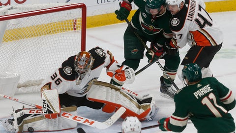 <p>               Anaheim Ducks goalie John Gibson, left, stops a shot as Hampus Lindholm, right, of Sweden, keeps Minnesota Wild's Eric Staal away from the rebound in the third period of an NHL hockey game, Thursday, Jan. 17, 2019, in St. Paul, Minn. The Ducks won 3-0. (AP Photo/Jim Mone)             </p>