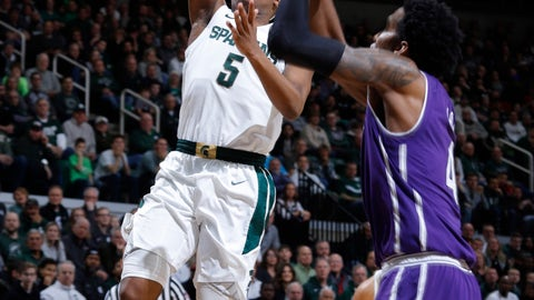 <p>               Michigan State's Cassius Winston, left, goes up for a layup against Northwestern's Vic Law during the first half of an NCAA college basketball game, Wednesday, Jan. 2, 2019, in East Lansing, Mich. (AP Photo/Al Goldis)             </p>