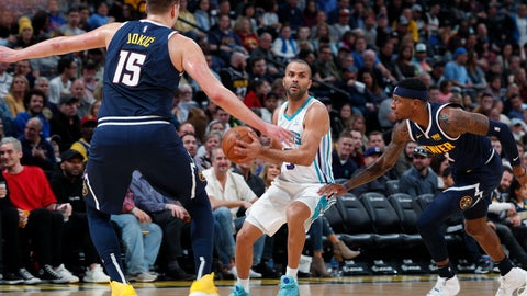 <p>               Charlotte Hornets guard Tony Parker, center, looks to pass the ball as Denver Nuggets center Nikola Jokic, left, and forward Torrey Craig cover in the first quarter of an NBA basketball game Saturday, Jan. 5, 2019, in Denver. (AP Photo/David Zalubowski)             </p>