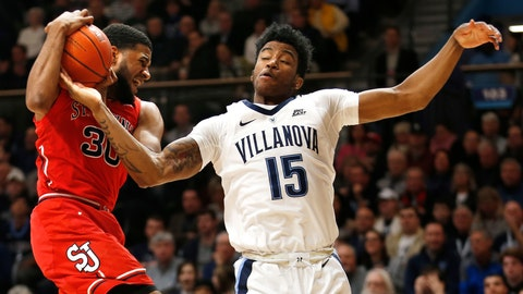 <p>               Villanova forward Saddiq Bey (15) tries to get a rebound away from St. John's guard LJ Figueroa (30) during the first half of an NCAA college basketball game, Tuesday, Jan. 8, 2019, in Villanova, Pa. (AP Photo/Laurence Kesterson)             </p>