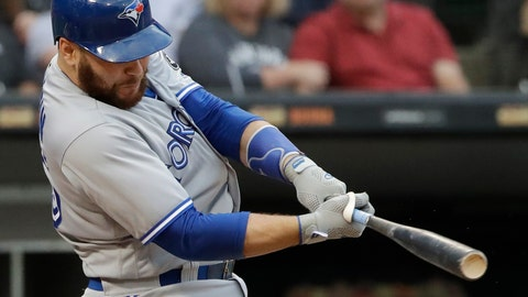 <p>               FILE - In this July 28, 2018, file photo, Toronto Blue Jays' Russell Martin hits a solo home run against the Chicago White Sox during the third inning of a baseball game in Chicago. The Los Angeles Dodgers have reacquired catcher Martin in a trade with Toronto, a day after losing free agent Yasmani Grandal to Milwaukee. (AP Photo/Nam Y. Huh, File)             </p>