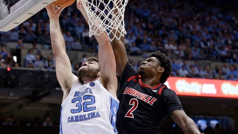 <p>               North Carolina's Luke Maye (32) shoots while Louisville's Darius Perry (2) defends during the first half of an NCAA college basketball game in Chapel Hill, N.C., Saturday, Jan. 12, 2019. (AP Photo/Gerry Broome)             </p>