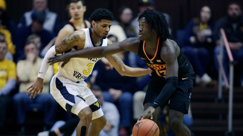<p>               Oklahoma State guard Isaac Likekele (13) drives up court while defended by West Virginia guard James Bolden (3) during the second half of an NCAA college basketball game Saturday, Jan. 12, 2019, in Morgantown, W.Va. (AP Photo/Raymond Thompson)             </p>