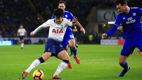 <p>               Tottenham Hotspur's Son Heung-min takes a shot to score his side's third goal of the game against Cardiff, during their English Premier League soccer match at Cardiff City Stadium in Cardiff, Wales, Tuesday Jan. 1, 2019. (Mark Kerton/PA via AP)             </p>