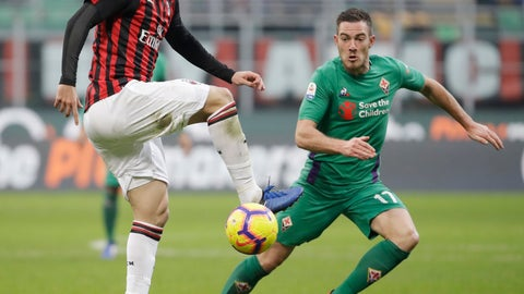 "<p>               FILE - In this Saturday, Dec. 22, 2018 filer, AC Milan's Gonzalo Higuain, left, challenges for the ball with Fiorentina's Jordan Veretout during a Serie A soccer match between AC Milan and Fiorentina, at the San Siro stadium in Milan, Italy. Amid reports of an imminent move to Chelsea and a mysterious fever, Gonzalo Higuain again lost his cool against his former club in what could have been his last match for AC Milan. Higuain was on the bench for most of Wednesday's Italian Super Cup against Juventus, officially due to ""fever"", but came on for the final 20 minutes. The Argentina forward had little impact and could not prevent 10-man Milan losing to Juventus but still made the headlines for the wrong reasons. (AP Photo/Luca Bruno, File )             </p>"
