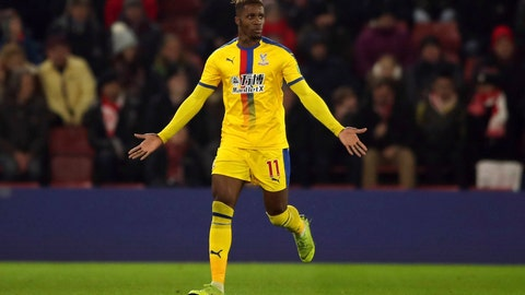 <p>               Crystal Palace's Wilfried Zaha celebrates scoring his side's first goal of the game against Southampton, during their English Premier League soccer match at St Mary's Stadium in Southampton, England, Wednesday Jan. 30, 2019. (Nick Potts/PA via AP)             </p>