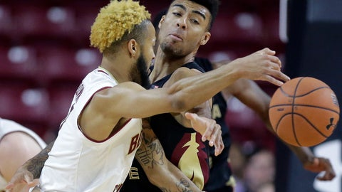 <p>               Boston College's Ky Bowman, left, tries to pass around Florida State's Anthony Polite, right, in the first half of an NCAA college basketball game, Sunday, Jan. 20, 2019, in Boston. (AP Photo/Steven Senne)             </p>