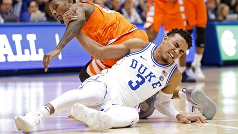 <p>               Duke's Tre Jones (3) tangles with Syracuse's Frank Howard during the first half of an NCAA college basketball game in Durham, N.C., Monday, Jan. 14, 2019. Jones was injured on the play and left the court. No. 1-for-now Duke will have to figure out how to play without perhaps its most irreplaceable player now that point guard Tre Jones is out indefinitely with a shoulder injury. (AP Photo/Gerry Broome)             </p>