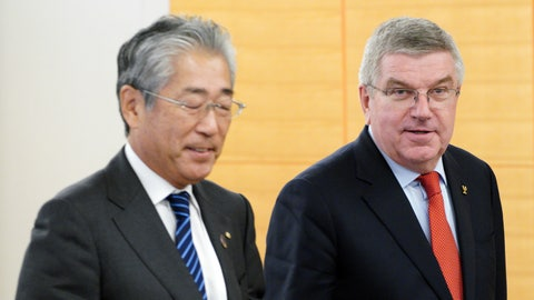 """<p>               FILE - In this Nov. 30, 2018, file photo, International Olympic Committee (IOC) President Thomas Bach, right, escorts Japanese Olympic Committee (JOC) President Tsunekazu Takeda during an IOC Executive Board meeting in Tokyo. France's financial crimes office says International Olympic Committee member Takeda is being investigated for corruption related to the 2020 Tokyo Olympics. The National Financial Prosecutors office says Takeda, the president of the Japanese Olympic Committee, was placed under formal investigation for """"active corruption"""" on Dec. 10.(AP Photo/Eugene Hoshiko, File)             </p>"""
