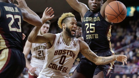 <p>               Boston College's Ky Bowman (0) and Florida State's Mfiondu Kabengele (25) chase the ball as Boston College forward Nik Popovic (21) looks on in the second half of an NCAA college basketball game, Sunday, Jan. 20, 2019, in Boston. (AP Photo/Steven Senne)             </p>