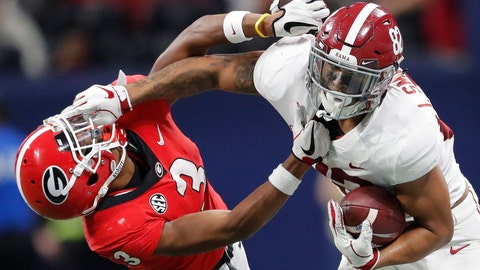 <p>               FILE - In this Dec. 1, 2018, file photo, Alabama tight end Irv Smith Jr. (82) hits Georgia defensive back Tyson Campbell (3) in the helmet during the first half of the Southeastern Conference championship NCAA college football game, in Atlanta. Irv Smith Jr. was determined to be a wide receiver in high school. Never mind that he's the son and nephew of former NFL tight ends and is built for that position, too. He caved to the reality his junior year at Brother Martin High School in New Orleans and moved to the family's favored position fulltime. Now, he has become a dangerous option for the Crimson Tide as both a pass catcher and blocker heading into Monday night's national championship game against Clemson in Santa Clara, California.(AP Photo/John Bazemore, File)             </p>
