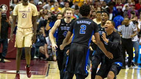 <p>               Duke guard Jordan Goldwire, right, forward RJ Barrett, center, and forward Jack White rush the court to celebrate with Cam Reddish after Reddish scored the game-winning jump shot against Florida State with less than a second left in the second half of an NCAA college basketball game in Tallahassee, Fla., Saturday, Jan. 12, 2019. Duke defeated Florida State 80-78. (AP Photo/Mark Wallheiser)             </p>