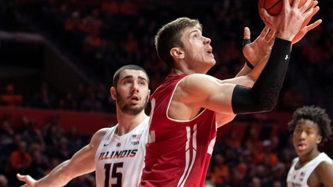 <p>               Wisconsin forward Ethan Happ (22) shoots past Illinois forward Giorgi Bezhanishvili (15) during the second half of an NCAA college basketball game in Champaign, Ill., Wednesday, Jan. 23, 2019. (AP Photo/Stephen Haas)             </p>