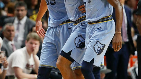 <p>               Memphis Grizzlies center Joakim Noah, left, and Memphis Grizzlies forward Justin Holiday, right, carry off Memphis Grizzlies forward Kyle Anderson, center, in the first half of an NBA basketball game against the Miami Heat, Saturday, Jan. 12, 2019, in Miami. (AP Photo/Brynn Anderson)             </p>