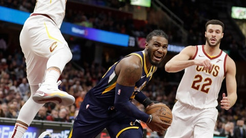<p>               Utah Jazz's Jae Crowder, center, drives between Cleveland Cavaliers' Tristan Thompson, left, and Larry Nance Jr., in the first half of an NBA basketball game, Friday, Jan. 4, 2019, in Cleveland. (AP Photo/Tony Dejak)             </p>