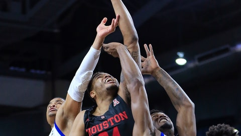 <p>               Houston's Breason Brady (24) battles Tulsa's Elijah Joiner and Martins Igbanu for a rebound during the first half of an NCAA college basketball game in Tulsa, Okla., Sunday, Jan. 27, 2019. (AP Photo/Dave Crenshaw)             </p>