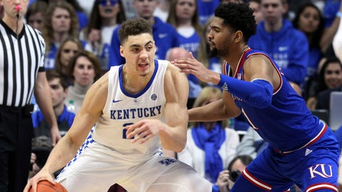 Kentucky's Reid Travis (22) drives on Kansas' Dedric Lawson during the second half of an NCAA college basketball game in Lexington, Ky., Saturday, Jan. 26, 2019. Kentucky won 71-63. (AP Photo/James Crisp)