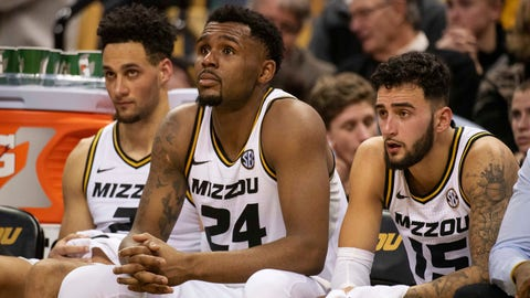 Missouri's K.J. Santos, left, Kevin Puryear, center, and Jordan Geist, right, watch the final minutes of their 87-63 loss to Tennessee from the bench during an NCAA college basketball game Tuesday, Jan. 8, 2019, in Columbia, Mo. (AP Photo/L.G. Patterson)
