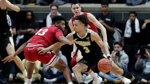 Purdue guard Carsen Edwards (3) drives around Indiana forward Juwan Morgan (13) during the first half of an NCAA college basketball game in West Lafayette, Ind., Saturday, Jan. 19, 2019. (AP Photo/Michael Conroy)