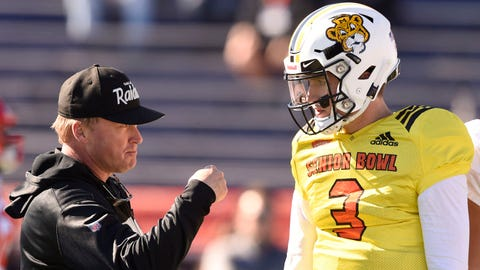 Jan 24, 2019; Mobile, AL, USA; North head coach Jon Gruden of the Oakland Raiders talks with North quarterback Drew Lock of Missouri (3) during the North squad 2019 Senior Bowl practice at Ladd-Peebles Stadium. Mandatory Credit: John David Mercer-USA TODAY Sports