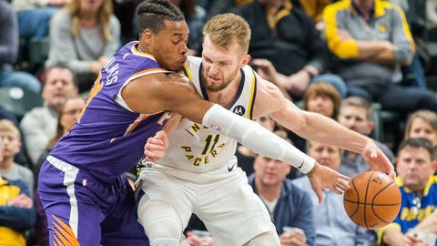Jan 15, 2019; Indianapolis, IN, USA; Indiana Pacers forward Domantas Sabonis (11) dribbles the ball while Phoenix Suns forward Richaun Holmes (21) defends in the second quarter at Bankers Life Fieldhouse. Mandatory Credit: Trevor Ruszkowski-USA TODAY Sports