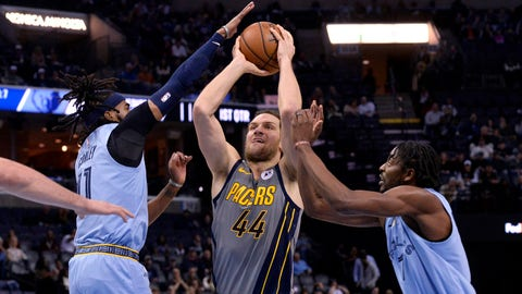 Indiana Pacers forward Bojan Bogdanovic (44) drives between Memphis Grizzlies guard Mike Conley, left, and forward Justin Holiday (7) during the first half of an NBA basketball game Saturday, Jan. 26, 2019, in Memphis, Tenn. (AP Photo/Brandon Dill)