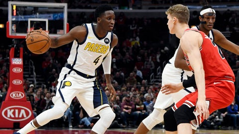Jan 4, 2019; Chicago, IL, USA; Indiana Pacers guard Victor Oladipo (4) handles the ball while defended by Chicago Bulls forward Lauri Markkanen (24) during the first half at United Center. Mandatory Credit: David Banks-USA TODAY Sports
