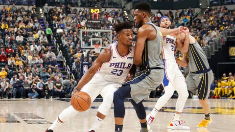 Jan 17, 2019; Indianapolis, IN, USA; Philadelphia 76ers forward Jimmy Butler (23) drives to the basket against Indiana Pacers forward Thaddeus Young (21) during the first quarter at Bankers Life Fieldhouse. Mandatory Credit: Brian Spurlock-USA TODAY Sports