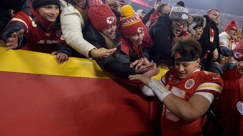 Jan 12, 2019; Kansas City, MO, USA; Kansas City Chiefs quarterback Patrick Mahomes (15) high fives fans after beating the Indianapolis Colts in an AFC Divisional playoff football game at Arrowhead Stadium. Mandatory Credit: Denny Medley-USA TODAY Sports
