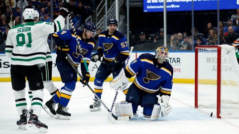 Dallas Stars' Tyler Seguin (91) celebrates after scoring against St. Louis Blues goaltender Jake Allen, right, during the first period of an NHL hockey game Tuesday, Jan. 8, 2019, in St. Louis. (AP Photo/Jeff Roberson)