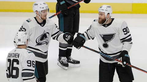 Central Division's Gabriel Landeskog, top left, of the Colorado Avalanche, is congratulated by Mikko Rantanen (96) and Ryan O'Reilly after scoring a goal against the Pacific Division during a semifinal in the NHL hockey All-Star Game in San Jose, Calif., Saturday, Jan. 26, 2019. (AP Photo/Jeff Chiu)