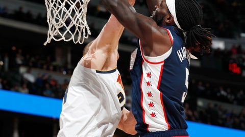<p>               Los Angeles Clippers forward Montrezl Harrell, front, dunks the ball for a basket over Denver Nuggets forward Mason Plumlee in the first half of an NBA basketball game Sunday, Feb. 24, 2019, in Denver. (AP Photo/David Zalubowski)             </p>