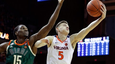 <p>               Virginia guard Kyle Guy (5) barbs a rebound next to Miami center Ebuka Izundu (15) during an NCAA college basketball game Saturday, Fe b. 2, 2019, in Charlottesville, Va. (AP Photo/Andrew Shurtleff)             </p>