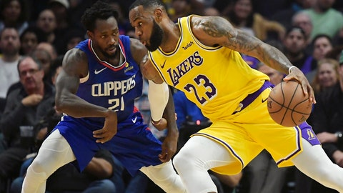 <p>               Los Angeles Lakers forward LeBron James, right, tries to drive past Los Angeles Clippers guard Patrick Beverley during the first half of an NBA basketball game Thursday, Jan. 31, 2019, in Los Angeles. (AP Photo/Mark J. Terrill)             </p>