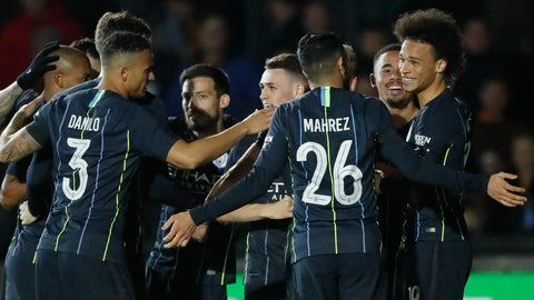 <p>               Manchester City's Leroy Sane, right, celebrates with his teammates after scoring his side's opening goal during the English FA Cup fifth round soccer match between Newport County and Manchester City at Rodney Parade stadium in Newport, Wales, Saturday, Feb. 16, 2019. (AP Photo/Frank Augstein)             </p>