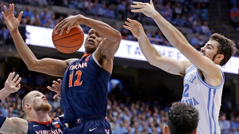 <p>               Virginia's De'Andre Hunter (12) and North Carolina's Luke Maye reach for a rebound during the first half of an NCAA college basketball game in Chapel Hill, N.C., Monday, Feb. 11, 2019. (AP Photo/Gerry Broome)             </p>