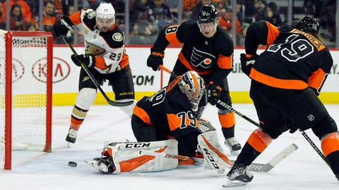 <p>               The puck goes past Philadelphia Flyers goalie Carter Hart, but wide of the net, during the third period of an NHL hockey game against the Anaheim Ducks, Saturday, Feb. 9, 2019, in Philadelphia. Looking on, from rear left, are Ducks' Devin Shore, Flyers' Robert Hagg and right, Nolan Patrick. The Flyers won 6-2. (AP Photo/Tom Mihalek)             </p>