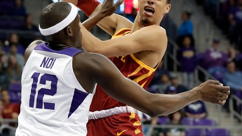 <p>               TCU forward Kouat Noi (12) blocks the lane forcing Iowa State guard Tyrese Haliburton (22) to pass the ball in the first half of an NCAA college basketball game in Fort Worth, Texas, Saturday, Feb. 23, 2019. (AP Photo/Tony Gutierrez)             </p>